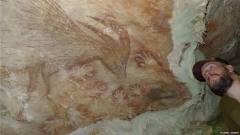 印尼发现年代最早远古人类壁画:手印与猪